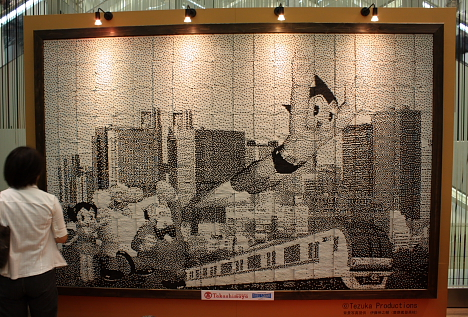 Astro Boy made from recycled train tickets --