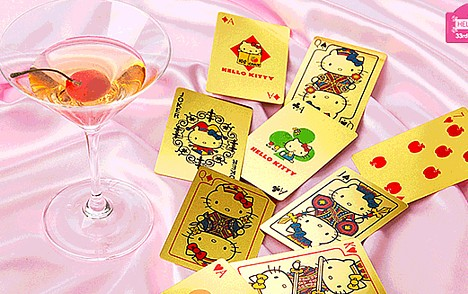 Solid gold Hello Kitty playing cards ---